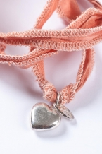 Silver charm on silk string (hart)