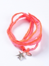 Silver charm on silk string (star)